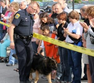 Police dog and crowd
